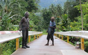 Chief Maia Tonjo (left) led his community in building a 67-metre bridge over the Tupukas River in Arawa, Bougainville.