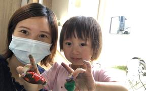 Lily Gao painting rocks with her 2yo daughter Elysse in the campervan.