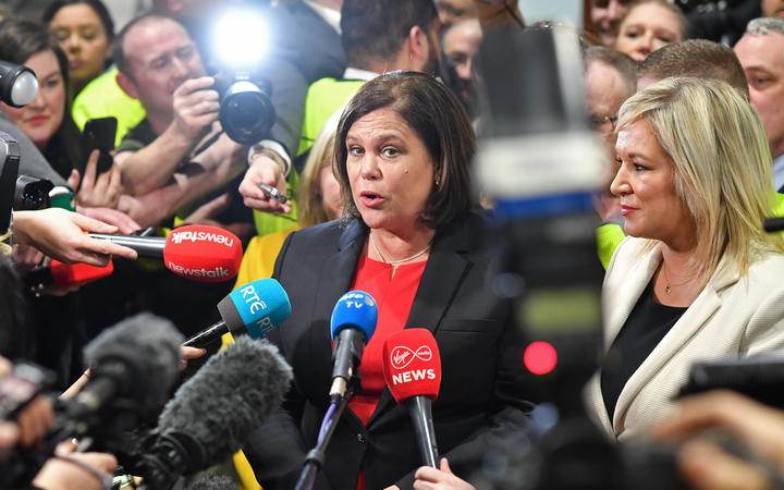 Sinn Féin party leader Mary Lou McDonald speaks to members of the media beside the party's Deputy First Minister of Northern Ireland, Michelle O'Neill.