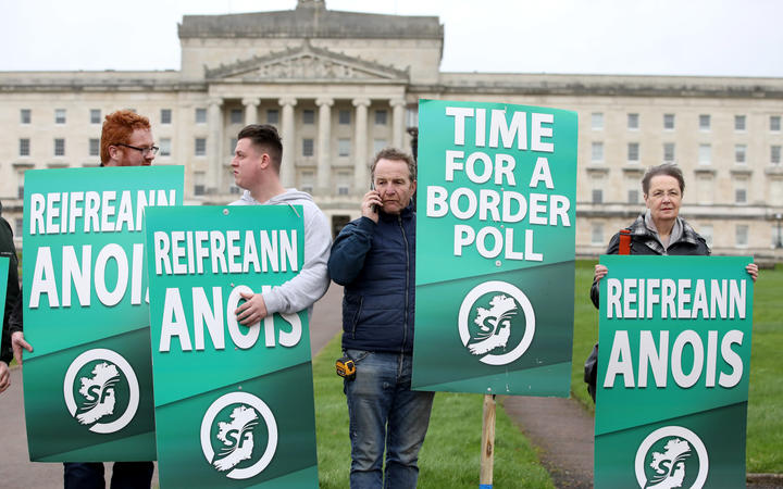 Sinn Fein activists protest at the Parliament Buildings on the Stormont Estate in Belfast against Brexit and call for a border poll on Irish Unity.