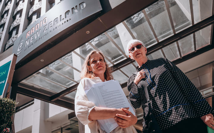 Margaret Guldborg and Elizabeth Kerr deliver a 26,000 signature petition to RNZ house in Wellington calling for a halt to proposed redundancies at RNZ Concert