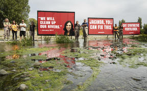 Billboards put up by Greenpeace at the Selwyn River in Canterbury.