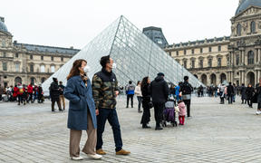 Chineese tourists wear face mask near the Louvre Museum in Paris, France, on 26 January 2020. (Photo by Jerome Gilles/NurPhoto)