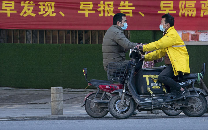 China's Hubei reports 1,843 new coronavirus cases