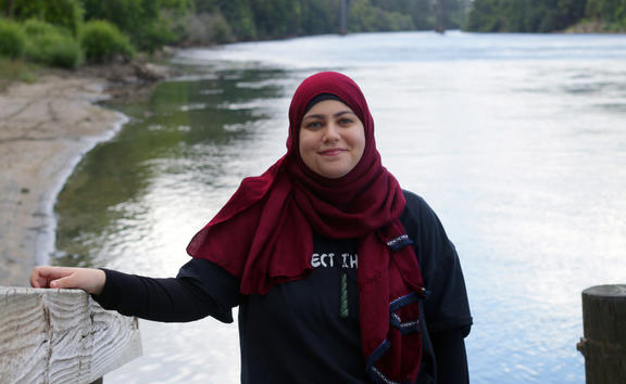 Shaymaa Arif on the riverside of the Waikato.