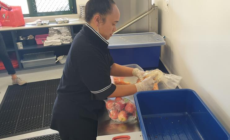 Parents put the meals into reusable bento boxes each morning, a task that provides paid jobs for 4 people.