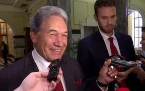 Winston Peters playing 'Radio Gaga' to press gallery reporters from his phone.