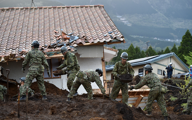 Troops from's Japan Ground Self-Defense Force search for survivors at a landslide site