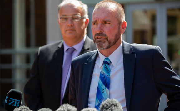 Detective Inspector Scott Beard, right, speaks to media outside the High Court at Auckland following the sentencing of Grace Millane's murderer, 21 February 2020.