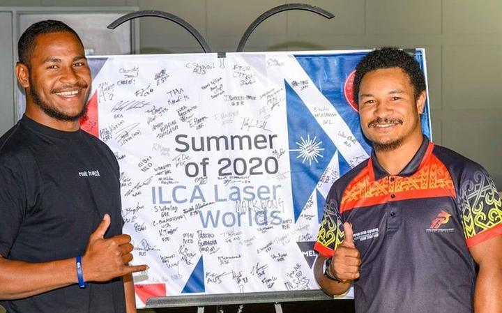 Te Ariki with his brother and coach Raymond Numa at the 2020 World Laser Championships.