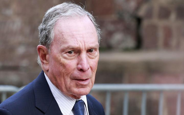 (FILES) In this file photo taken on May 15, 2019 Michael Bloomberg arrives to the opening celebration of the Statue of Liberty Museum on Liberty Island at the Statue Cruises Terminal in Battery Park in New York.