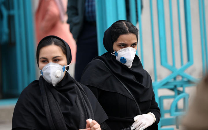 People wear masks after deaths and new confirmed cases revealed from the coronavirus in Tehran, Iran.