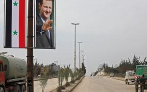 A poster of Syrian President Bashar al-Assad adorning the M5 highway connecting Aleppo to Damascus on February 18, 2020.