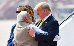 India's Prime Minister Narendra Modi (left) embraces US President Donald Trump upon his arrival at Sardar Vallabhbhai Patel International Airport on 24 February, 2020.