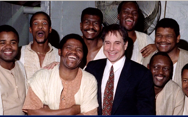 Joseph Shabalala, front left with members of Ladysmith Black Mambazo and Paul Simon