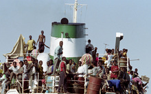 Refugees have risked their lives by fleeing into the ocean for decades, including in 1992 when hundreds of Somalians crammed aboard this boat.