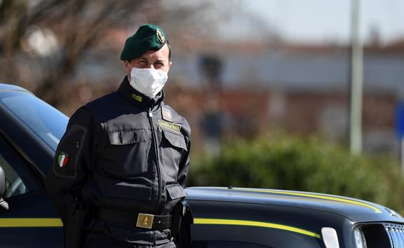 Italian police officer at a checkpoint at the small town of Zorlesco, southeast of Milan, on February 26, 2020.