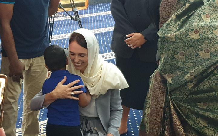 Ardern hugs the great grandson of Ashraf Ali Razak, who died in the mosque attack.