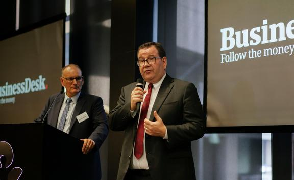 Pattrick Smellie (left) watches finance minister Grant Robertson at the Auckland launch of BusinessDesk subscriber service on Wednesday.