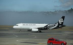 An Air New Zealand plane at Wellington Airport as fog causes delays and cancellations.