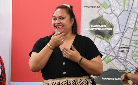 Tongan parliamentary staffer Veisinia Latu performs with Tāmaki Regeneration Company staff in Auckland