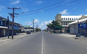 A main streets in Samoa's capital Apia on Thursday, the first day of a govenment shutdown and travel ban aimed at allowing mobile medical teams to visit people in need of vaccinations at their homes.