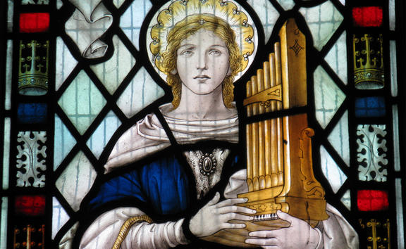 Saint Cecilia in a window in the church of St Mary the Virgin in Little Wymondley in Hertfordshire