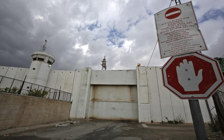 The crossing gate between the Israeli occupied West Bank city of Bethlehem and Jerusalem remains closed on March 6, 2020, following a lockdown on the biblical city, after the first Palestinian cases of the deadly coronavirus were discovered there.