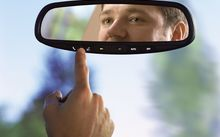 A driver checks his rear view mirror (file)