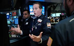 Traders work on the floor of the New York Stock Exchange (NYSE) on March 09, 2020 in New York City. As global fears from the coronavirus continue to escalate, trading was halted for 15 minutes after the opening bell as stocks fell 7 percent.