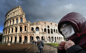 Italy's popular tourist spots like the Colosseum in Rome are nearly deserted as a nationwide ban on public gatherings takes effect.