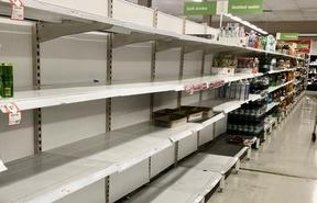 Shelves where disinfectant wipes ,toilet tissues, bottled water, flu medicines are usually displayed are nearly empty at a  local store on March 03, 2020 in Rhodes area ,Sydney, Australia.