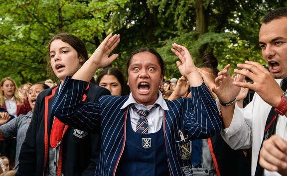 School students perform a haka during a vigil in Christchurch on March 18, 2019, three days after a shooting incident at two mosques in the city that claimed the lives of 50 Muslim worshippers. (Photo by ANTHONY WALLACE / AFP)