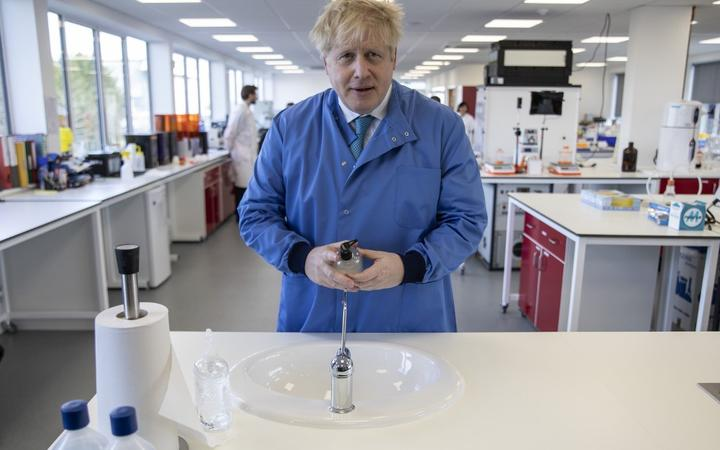 Britain's Prime Minister Boris Johnson gestures during a visit to the Mologic Laboratory in the Bedford technology Park, north of London on March 6, 2020. -