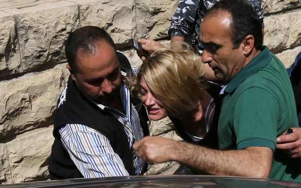 Australian TV reporter Tara Brown is escorted from a Lebanese courtroom.