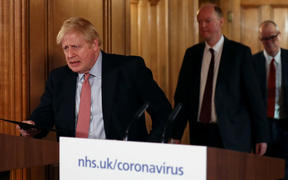 Britain's Prime Minister Boris Johnson  arrives at a news conference addressing the government's response to the novel coronavirus COVID-19 outbreak, at 10 Downing Street.