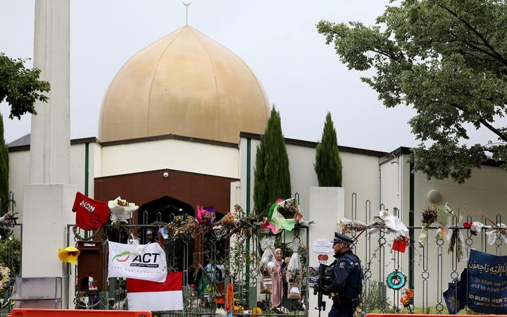An armed police officer outside Al Noor Mosque in Christchurch, April 2019.