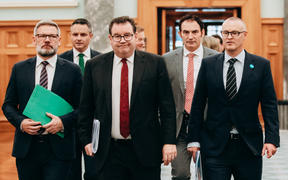Finance Minister Grant Robertson (centre) and other MPs have been discussing the economic relief package.