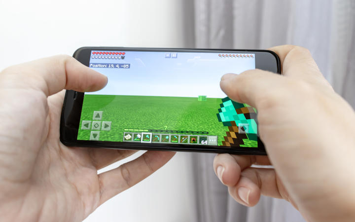 A smartphone with online multiplayer game Minecraft.