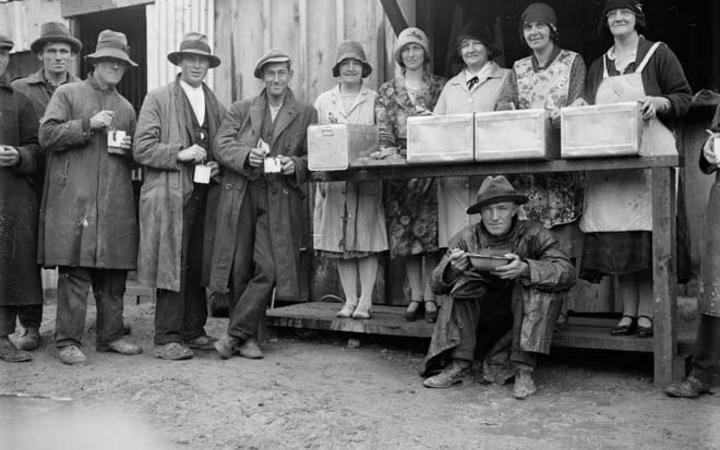 For people who lost their jobs and had few savings the early years of the 1930s were tough. Here a group of men queue with their enamel mugs for some hot soup.