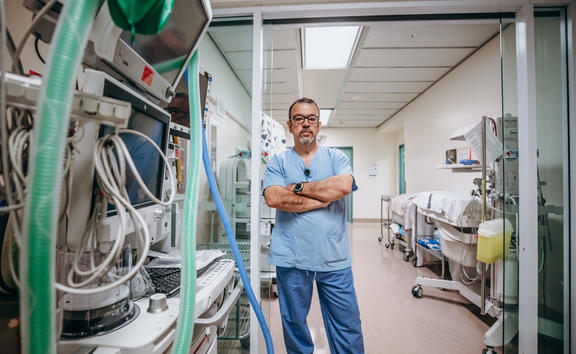 Dr Alberto Ramirez - lead anaesthetist at Palmerston North hospital - stands in corridor used to store expensive equipment.