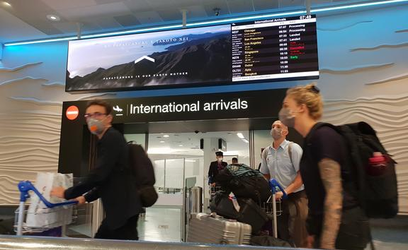 Travellers with face masks at Auckland Airport international arrivals during the Covid-19 coronavirus outbreak on 20/3/2020.