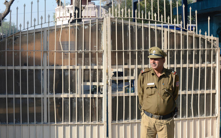 An Indian policeman keeps watch outside Tihar Jail, where four men who were convicted for rape and murder were executed.