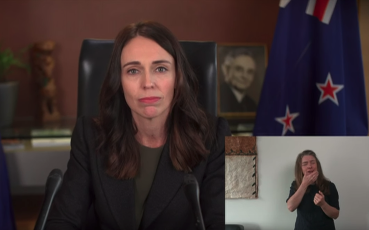 New Zealand's Ardern keeps schools open, urges limits on movement