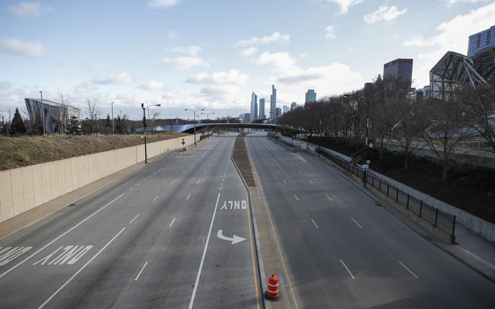 Columbus Drive is seen empty in downtown Chicago, Illinois, on March 21, 2020.