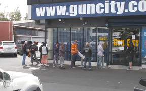 Queues at Gun City as New Zealand prepares for Covid-19 lockdown.