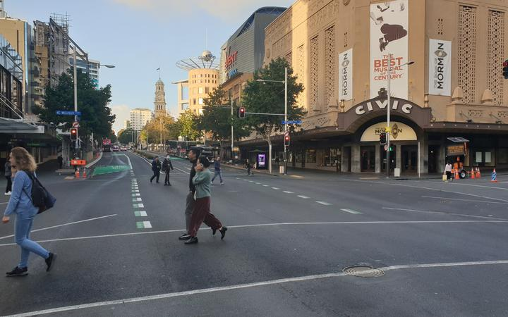 Few people were at Queen St's usually busy intersection after the country moved into alert level 3 to battle the Covid-19 pandemic.