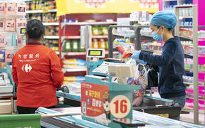 People shop at a supermarket in Wuhan, central China's Hubei Province, March 24, 2020.
