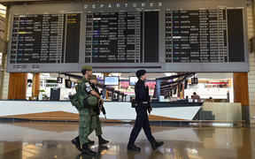 Armed military and police personnel patrol at Changi international airport terminal in Singapore on 30 January 2020.