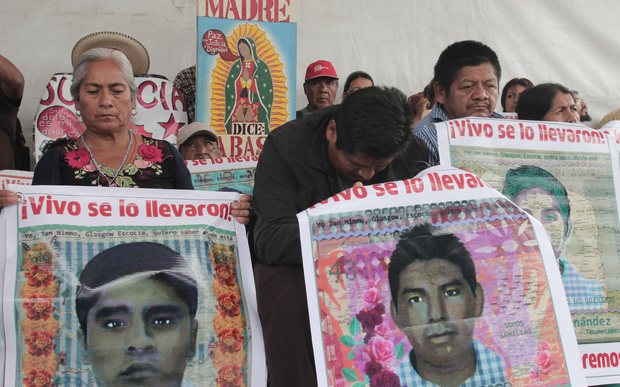 Relatives of the 43 missing students from Ayotzinapa protest at Zocalo Square in Mexico City.
